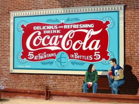 Coca cola mural on wall real estate building restored news for Coca cola wall mural